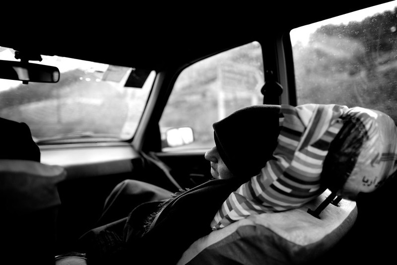 . Breast cancer patient Soheila Mehri, sleeps in the car on the way to the hospital for radiotherapy treatment in Tehran on February 23, 2013, after the cancer spread to her brain.  AFP PHOTO/BEHROUZ MEHRI