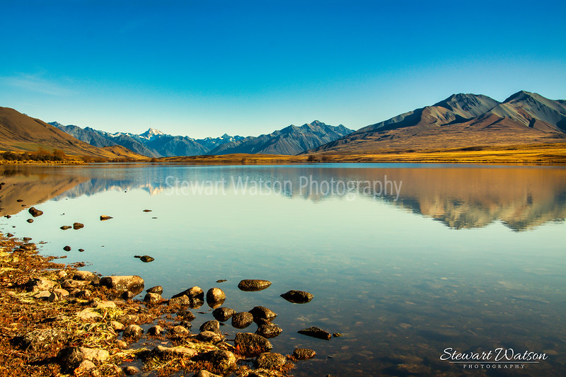 The Southern Alps reflected in Lake Clearwater, Ashburton Lakes
