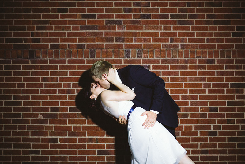 Night Photos of Bride and Groom in Rockford IL outside of the Verdi Club in downtown Rockford by Mindy Joy Photography