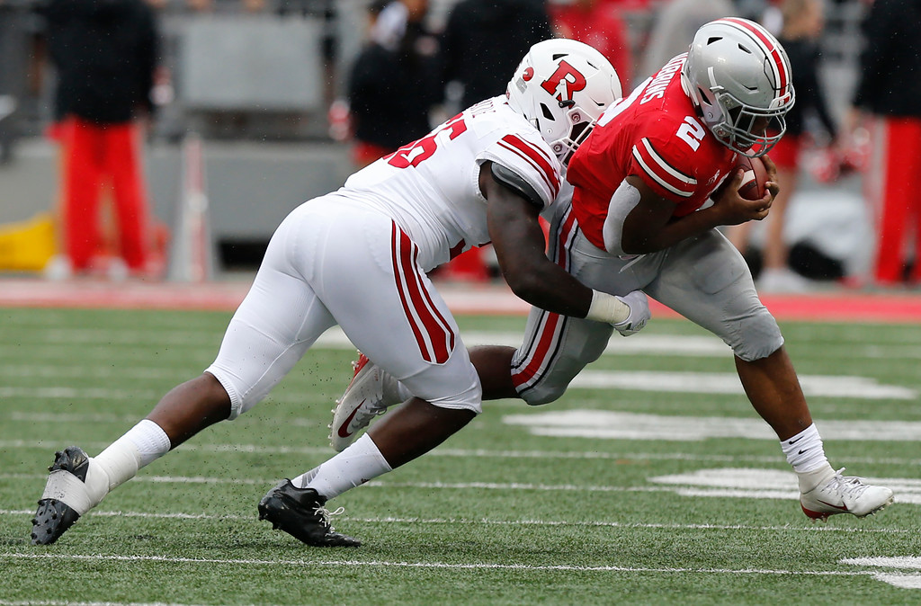 . Rutgers linebacker Rashawn Battle, left, tries to tackle Ohio State running back J.K. Dobbins during the first half of an NCAA college football game Saturday, Sept. 8, 2018, in Columbus, Ohio. (AP Photo/Jay LaPrete)