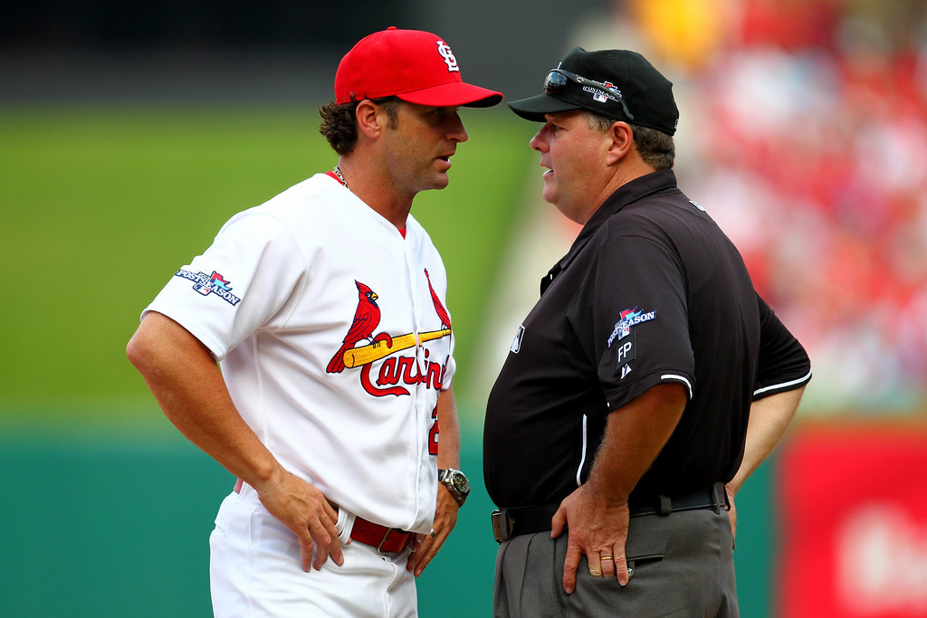 . ST LOUIS, MO - OCTOBER 04:  Manager Mike Matheny #22 of the St. Louis Cardinals argues with first base umpire Jerry Layne in the seventh inning against the Pittsburgh Pirates during Game Two of the National League Division Series at Busch Stadium on October 4, 2013 in St Louis, Missouri.  (Photo by Dilip Vishwanat/Getty Images)