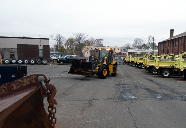 11/15/18 Wesley Bunnell | Staff New Britain Public Works trucks were being prepped and loaded with salt in anticipation of the upcoming winter storm schedule to hit New England Thursday evening into Friday. A payloader makes its way back to its parking spot after being washed down from the salt it uses to load the city plow trucks.