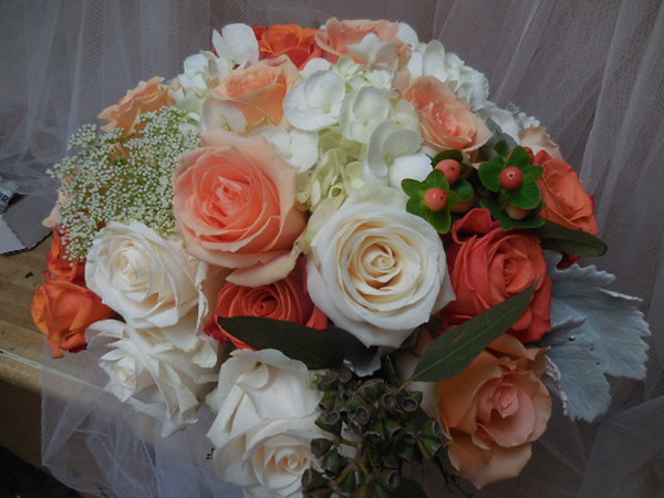 White hydrangea, orange, peach, white roses, peach beans- grey miller  $120-$135