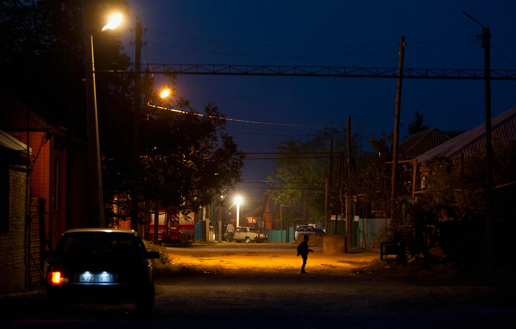 . A boy walks along the street in Chiri-Yurt, the village where the Tsarnaev family has its roots, in Chechnya, Russia April 29, 2013. The naming of two Chechens, Dzhokhar and Tamerlan Tsarnaev, as suspects in the Boston Marathon bombings has put Chechnya - the former site of a bloody separatist insurgency - back on the world\'s front pages. Chechnya appears almost miraculously reborn. The streets have been rebuilt. Walls riddled with bullet holes are long gone. New high rise buildings soar into the sky. Spotless playgrounds are packed with children. A giant marble mosque glimmers in the night. Yet, scratch the surface and the miracle is less impressive than it seems. Behind closed doors, people speak of a warped and oppressive place, run by a Kremlin-imposed leader through fear.   Picture taken April 29, 2013.   REUTERS/Maxim Shemetov