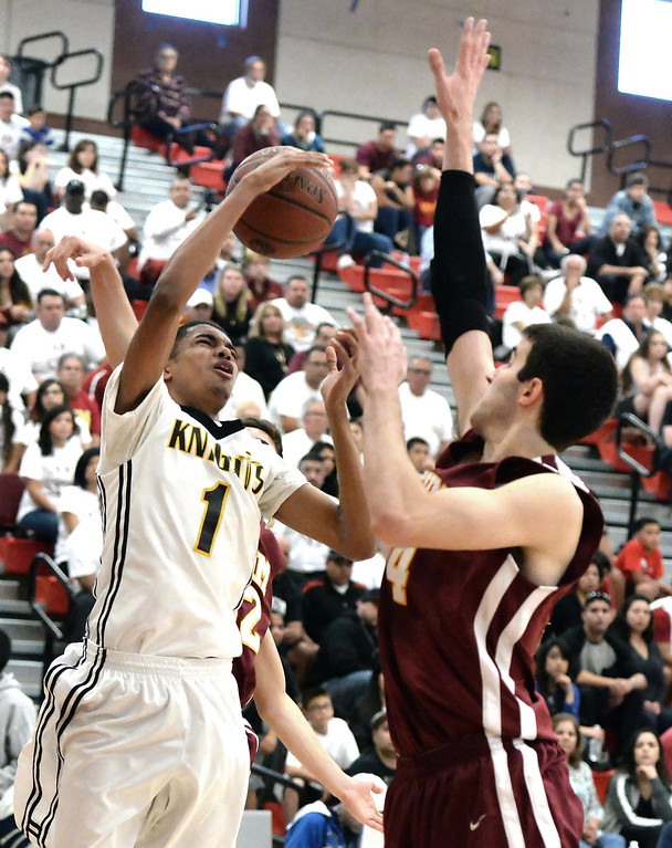 . Bishop Montgomery \'s Stephen Thompson Jr. (1) is fouled by Cantwell\'s Andrew Martinez in the first half of a CIF Southern California Regional Division IV basketball game at Colony High School in Ontario, Calif., on Saturday, March 22, 2014.  (Keith Birmingham Pasadena Star-News)
