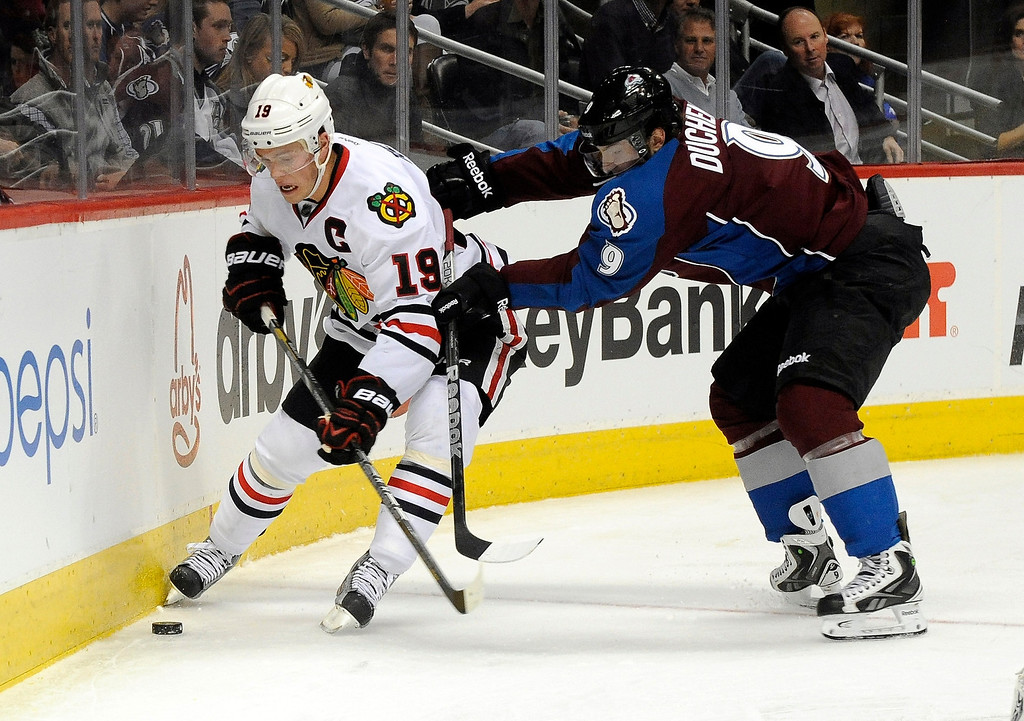. Colorado Avalanche center Matt Duchene (9) and Chicago Blackhawks center Jonathan Toews (19) fight for the puck during the second period of an NHL hockey game, Monday, March 18, 2013, in Denver. (AP Photo/Jack Dempsey)