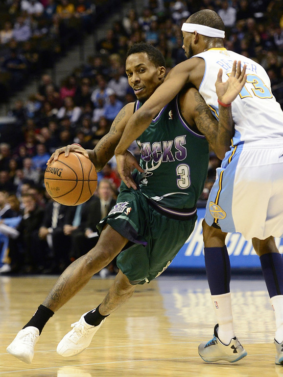 . DENVER, CO - FEBRUARY 5: Corey Brewer Denver Nuggets (13) fouls Brandon Jennings Milwaukee Bucks (3) during the first half. The Denver Nuggets take on the Milwaukee Bucks in NBA action. (Photo By AAron Ontiveroz/The Denver Post)