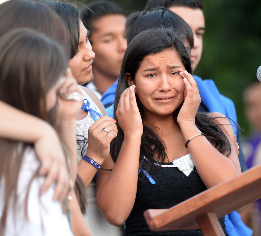 . Emerald Fimbres, cousin of Adrian Castro, cries during a memorial gathering for him at El Monte High School Monday evening April 14, 2014. Castro was one of nine students killed in the bus crash in Orland, Calif. (Staff Photo by Keith Durflinger/San Gabriel Valley Tribune)