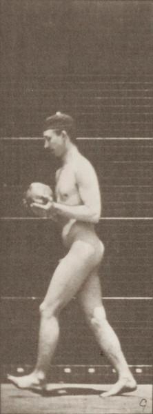Nude man descending a stepladder