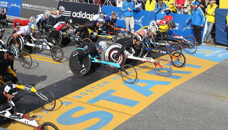 . Defending champion Joshua Cassidy, of Canada, fifth front right, starts the wheelchair division of the 117th running of the Boston Marathon, in Hopkinton, Mass., Monday, April 15, 2013. (AP Photo/Stew Milne)