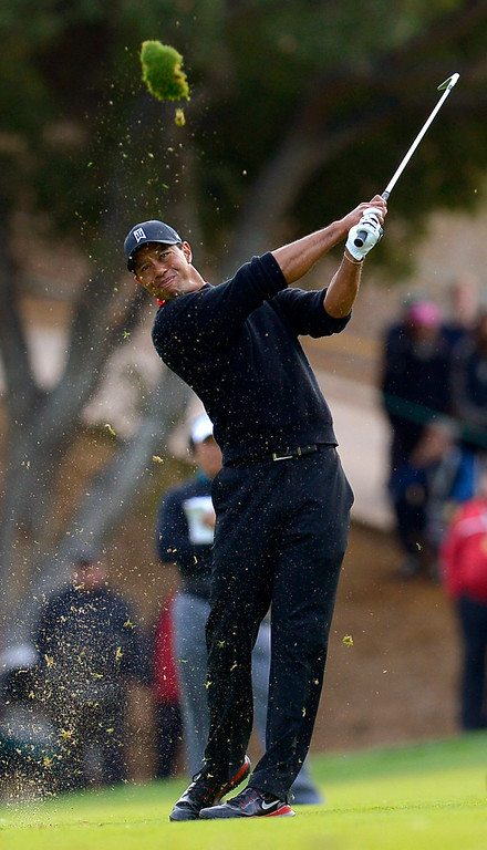. Tiger Woods hits a shot into the sand on a playoff hole with Zach Johnson during the final round of the Northwestern Mutual World Challenge golf tournament at Sherwood Country Club, Sunday December 8, 2013, in Thousand Oaks, Calif.   Johnson would go on to beat Tiger Woods.(Andy Holzman/Los Angeles Daily News)