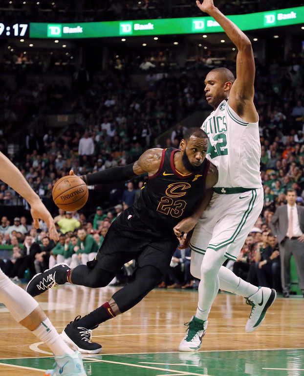 . Cleveland Cavaliers forward LeBron James drives against Boston Celtics forward Al Horford, right, during the first half in Game 7 of the NBA basketball Eastern Conference finals, Sunday, May 27, 2018, in Boston. (AP Photo/Elise Amendola)