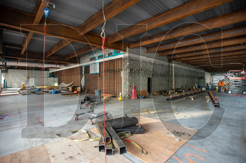 A new concrete slab-on-deck floor has been poured to create a series of second-story office shells in the Exchange Building. Above, existing steel beams have had asbestos fireproofing removed leaving bare, oxidized steel. (Josh Kulla/DJC)