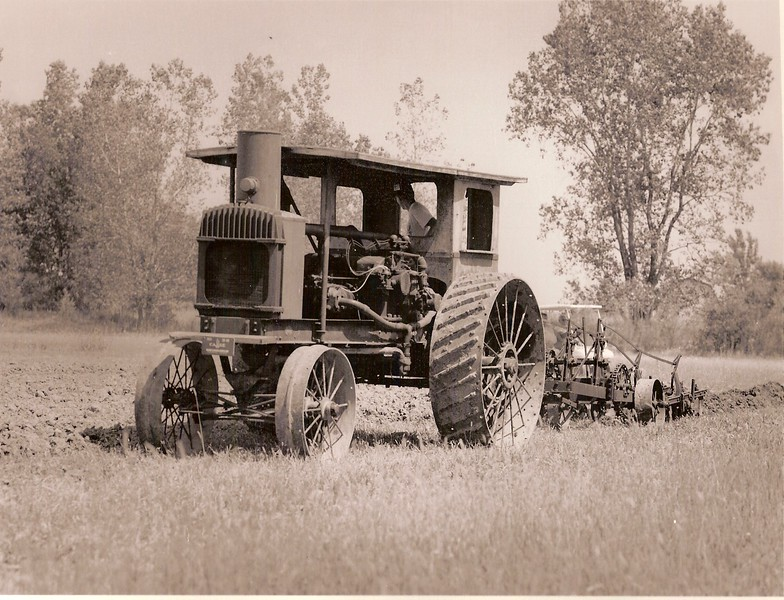 Plowing with Grand Detour plow.jpg