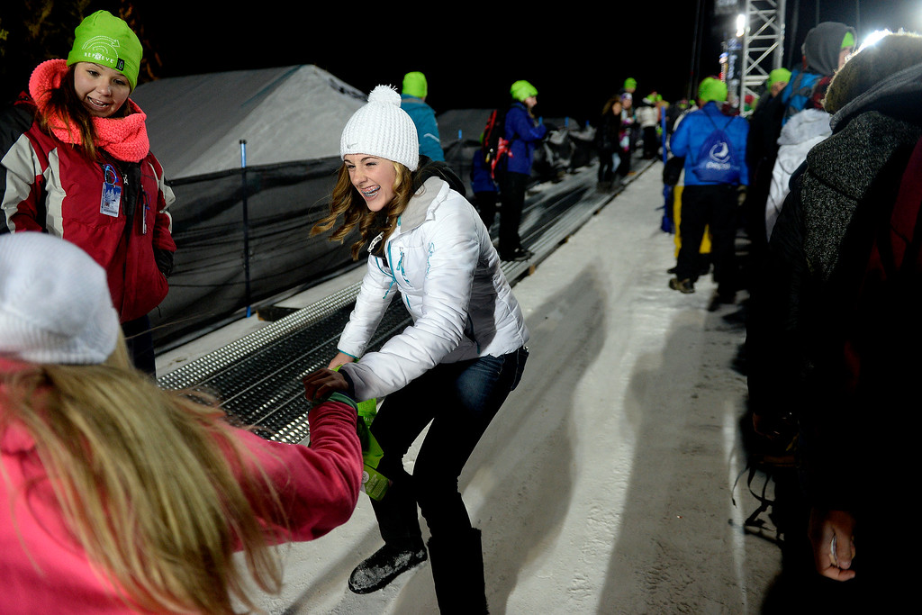 . Nicole Monney (right), 14, slides with her friend Kaitlyn Harlow, 14, during the women\'s snowboard halfpipe. X Games Aspen at Buttermilk on Friday, January 25, 2014. (Photo by AAron Ontiveroz/The Denver Post)