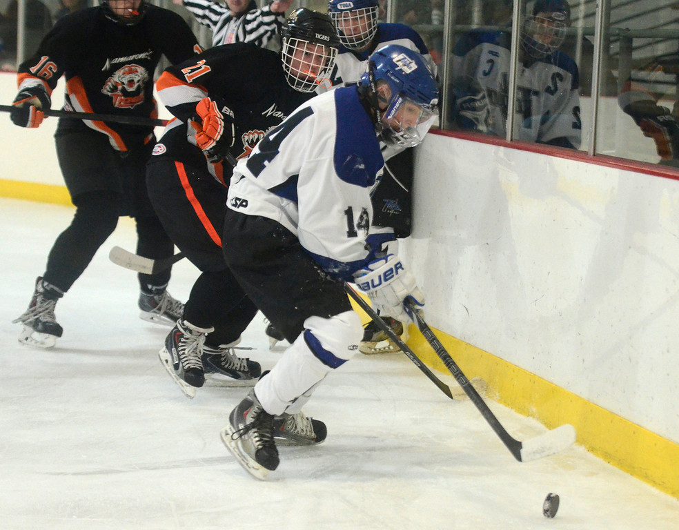 . Ed Burke - The Saratogian 12/06/13 Saratoga\'s Drew Patterson works the puck behind the net as Mamaroneck defenders close in during Friday\'s opening round of the Don Kauth Memorial Tournament.