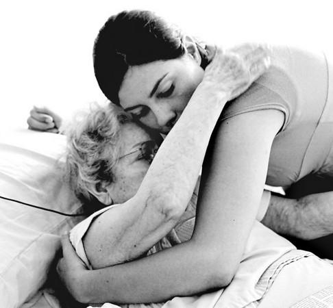 Sarah gives Grandma a hug.