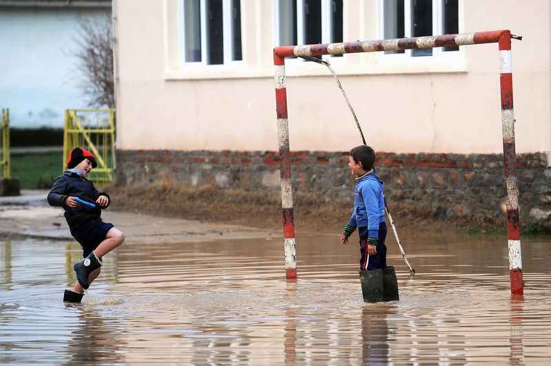 . Two boys pretend to be playing football in the flooded schoolyard in the village of Murtino, in the southeastern tip of the Republic of Macedonia on February 27, 2013. The torrential rains which in the last three days poured down on the fertile Strumica Valley inundated fields and villages, destroying or damaging crops and households.  Other parts in Eastern Macedonia had their share of flooding in the first half of the week.  ROBERT ATANASOVSKI/AFP/Getty Images