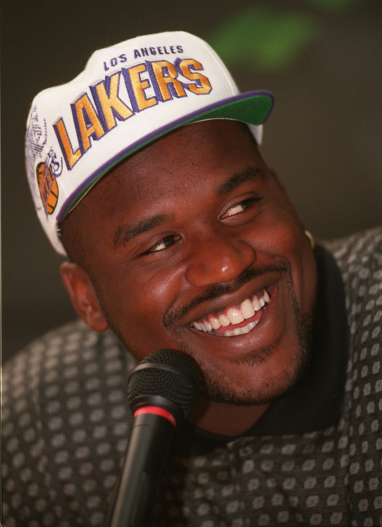 . Olympic Dream team member Shaquille O\'Neal smiles during a news conference Thursday July 18, 1996 in Atlanta where he confirmed his seven-year, $120 million contract with the Los Angeles Lakers.  (AP Photo/Hans Deryk)
