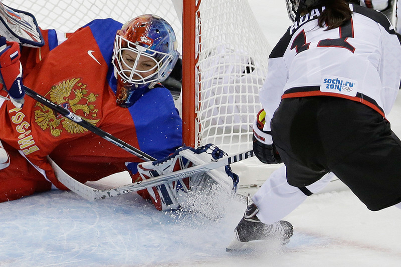 . Goalkeeper Anna Prugova of Russia blocks a goal attempt by Yurie Adachi of Japan during the first period of the 2014 Winter Olympics women\'s ice hockey game at Shayba Arena, Tuesday, Feb. 11, 2014, in Sochi, Russia. (AP Photo/Mark Humphrey)
