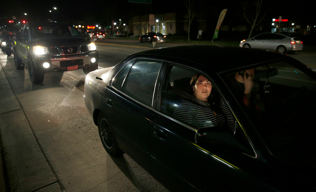 . Kendra Curieo waits in traffic to evacuate Marysville, Calif., Sunday, Feb. 12, 2017. Thousands of residents of Marysville and other Northern California communities were told to leave their homes Sunday evening as an emergency spillway of the Oroville Dam could fail at any time unleashing flood waters from Lake Oroville, according to officials from the California Department of Water Resources. (AP Photo/Rich Pedroncelli)