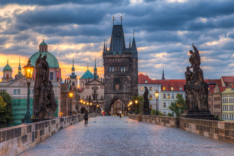 Charles Bridge morning  One of the worst things you can encounter while editing a photo is a slow computer. And my is slowly driving me crazy. It's a great PC, I have it already for more than 5 year without any problems, but the Lighroom, Bridge and Photoshop combo is just too much for it recently. I'm already looking for a new one.. something really fast :)  About the photo. This one is taken early morning on the Charles Bridge, right at the time the sunrise started :)