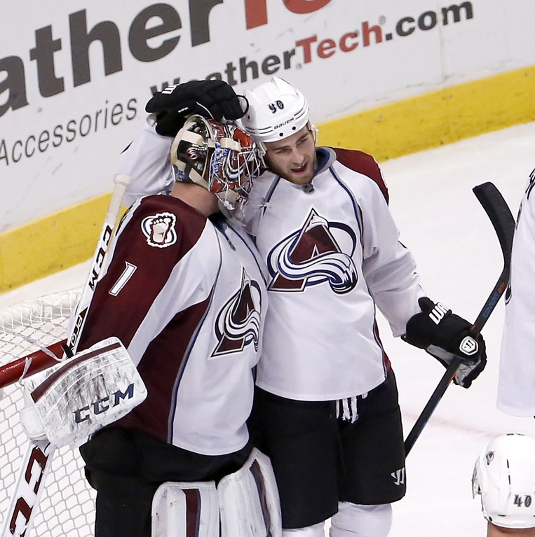 . Colorado Avalanche center Ryan O\'Reilly (90) celebrates with goalie Semyon Varlamov (1) the Avalanche\'s 2-0 win over the Chicago Blackhawks after an NHL hockey game Tuesday, Jan. 6, 2015, in Chicago.  (AP Photo/Charles Rex Arbogast)
