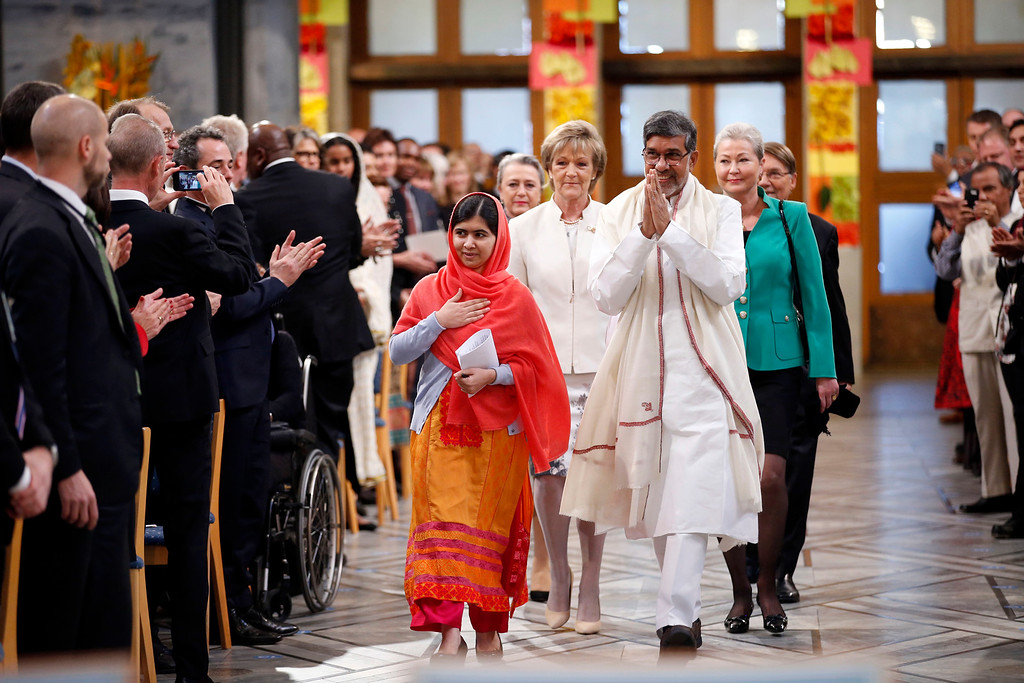 . Nobel Peace Prize winners Malala Yousafzai from Pakistan, center left, and Kailash Satyarthi of India arrive for the Nobel Peace Prize award ceremony in Oslo, Norway, Wednesday, Dec. 10, 2014.  The Nobel Peace Prize is being shared between Malala Yousafzai, the 17-year-old Taliban attack survivor, and the youngest Nobel Prize winner ever, and Indian children\'s rights activist Kailash Satyarthi in a ceremony in Oslo on Wednesday.  (AP Photo/Cornelius Poppe, Scanpix)