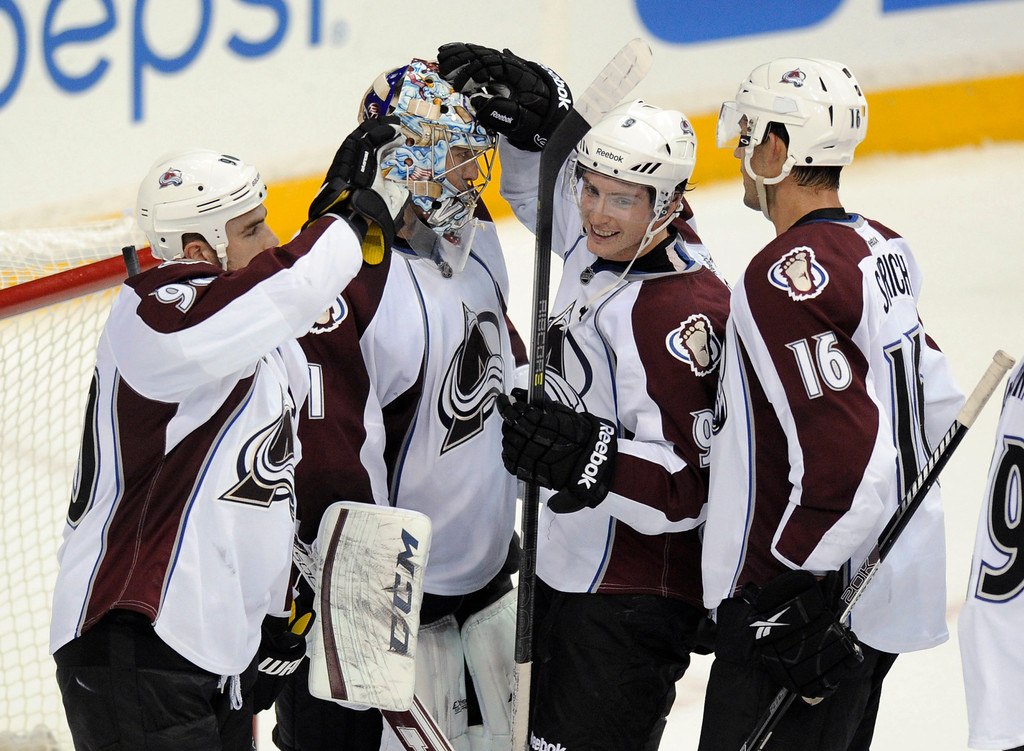 . Colorado Avalanche goalie Semyon Varlamov (1), of Russia, celebrates the team\'s 5-1 win over the Washington Capitals with Ryan O\'Reilly, left, Matt Duchene (9) and Cory Sarich (16) after an NHL hockey game, Saturday, Oct. 12, 2013, in Washington. (AP Photo/Nick Wass)