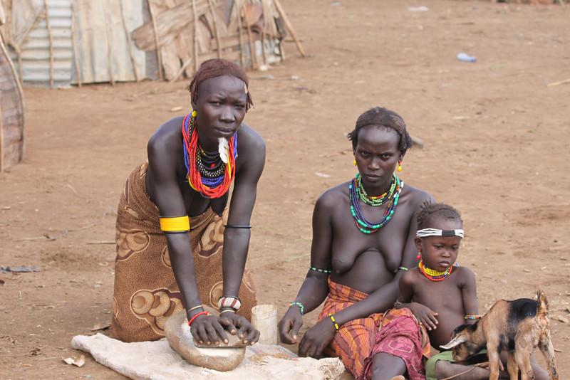 Dasanech women preparing food