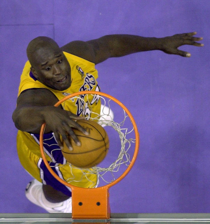 . Los Angeles Lakers\' Shaquille O\'Neal dunks during the second quarter against the New Jersey Nets in Game 1 of the NBA Finals Wednesday, June 5, 2002, in Los Angeles. (AP Photo/Michael Conroy)