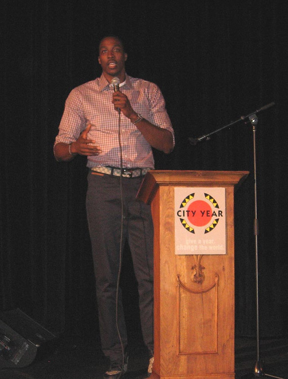 """. Los Angeles Lakers center Dwight Howard congratulated graduating CityYear members for helping youths \""""achieve their dreams\"""" in the inner city."""
