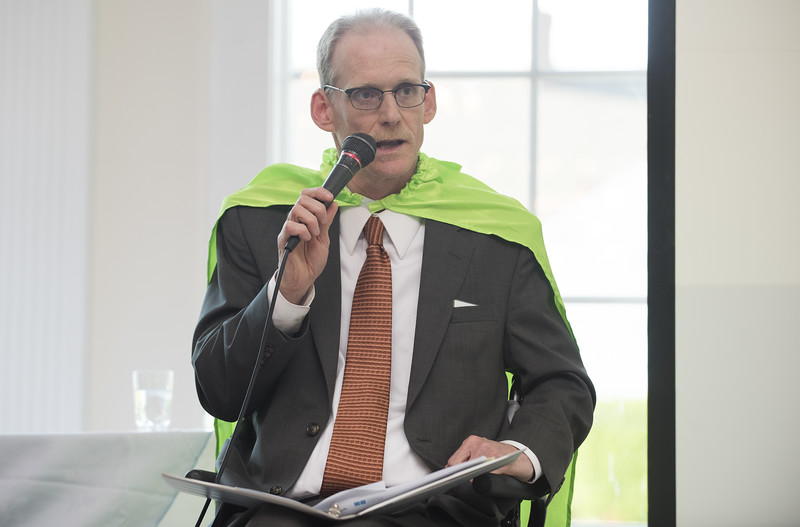 06/12/19  Wesley Bunnell | Staff  David Kelly the Chairman of the Board of the Center of Special Care concludes the hospital's meeting on June 12, 2019 at the Aqua Turf in Southington. Kelly is wearing a superheroes cape as part of the hospital's Superheroes Campaign.