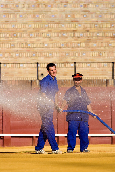 Maestranza bullring employees watering the arena before a bullfight, Seville, autonomous community of Andalusia, southern Spain