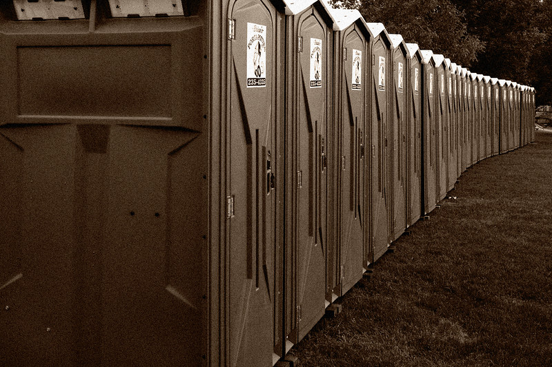 A line of portapotties at the Greek festival