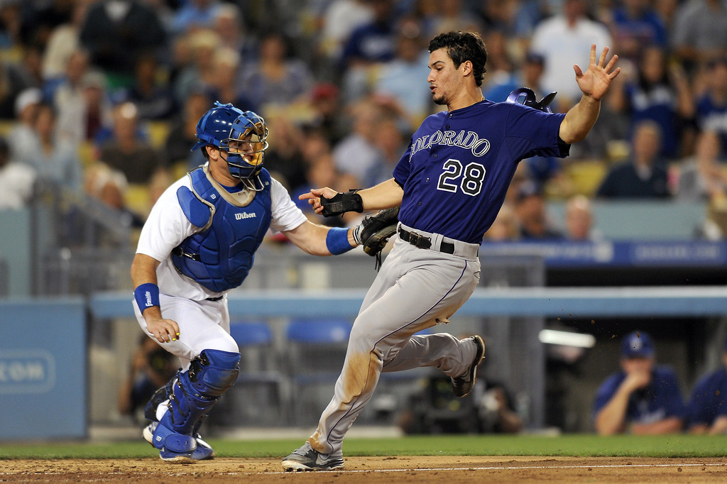 . The Rockies Nolan Arenado gets past Dodgers catcher A.J. Ellis to score from second on a single by DJ LeMahieu in the fifth inning, Friday, July 12, 2013, at Dodger Stadium. (Michael Owen Baker/Staff Photographer)