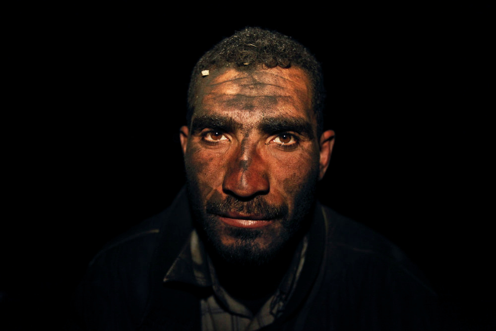 . Palestinian worker Hamuda Mahdi, who oversees production of coal at night, poses for a photograph at one of the few local charcoal manufacturing shops, east of Gaza City on March 27, 2013. In adapting to years of border blockades and shortages, Gazans have become experts at recycling and making new out of old including turning scrap wood into charcoal to be used for barbecue grills and water pipes in local restaurants and coffee houses. (AP Photo/Hatem Moussa)