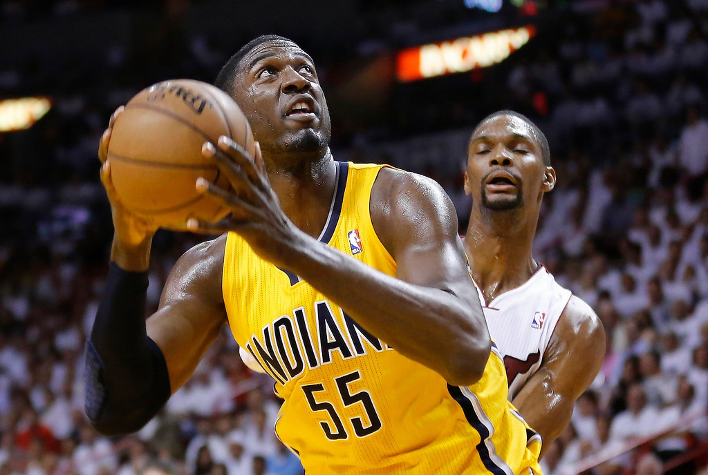 . Indiana Pacers Roy Hibbert (L) goes up to the basket past Miami Heat\'s Chris Bosh during Game 7 of their NBA Eastern Conference final basketball playoff in Miami, Florida June 3, 2013. REUTERS/Joe Skipper