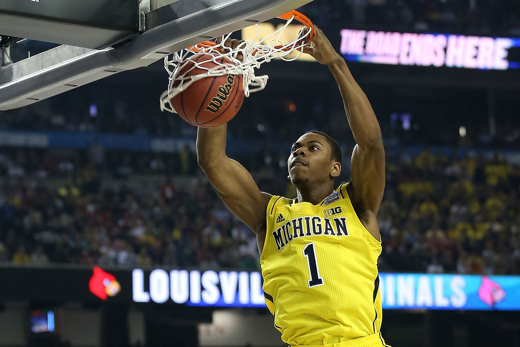 . Glenn Robinson III #1 of the Michigan Wolverines dunks in the first half against the Louisville Cardinals during the 2013 NCAA Men\'s Final Four Championship at the Georgia Dome on April 8, 2013 in Atlanta, Georgia.  (Photo by Streeter Lecka/Getty Images)