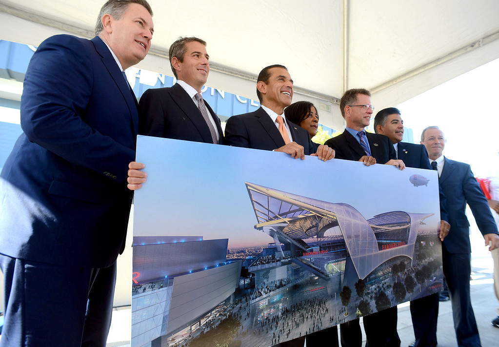 . AEG President Tim Leiweke (lft) joins Mayor Antonio Villaraigosa and other officials for a photo with a rendering of Farmers Field following a press conference outside the Los Angeles Convention Center Wednesday, October 3, 2012.  (Andy Holzman/L.A. Daily News)