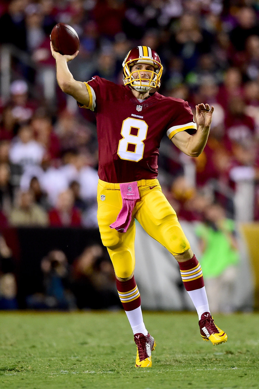 . Quarterback Kirk Cousins #8 of the Washington Redskins throws a second quarter touchdown pass against the Seattle Seahawks at FedExField on October 6, 2014 in Landover, Maryland.  (Photo by Patrick Smith/Getty Images)