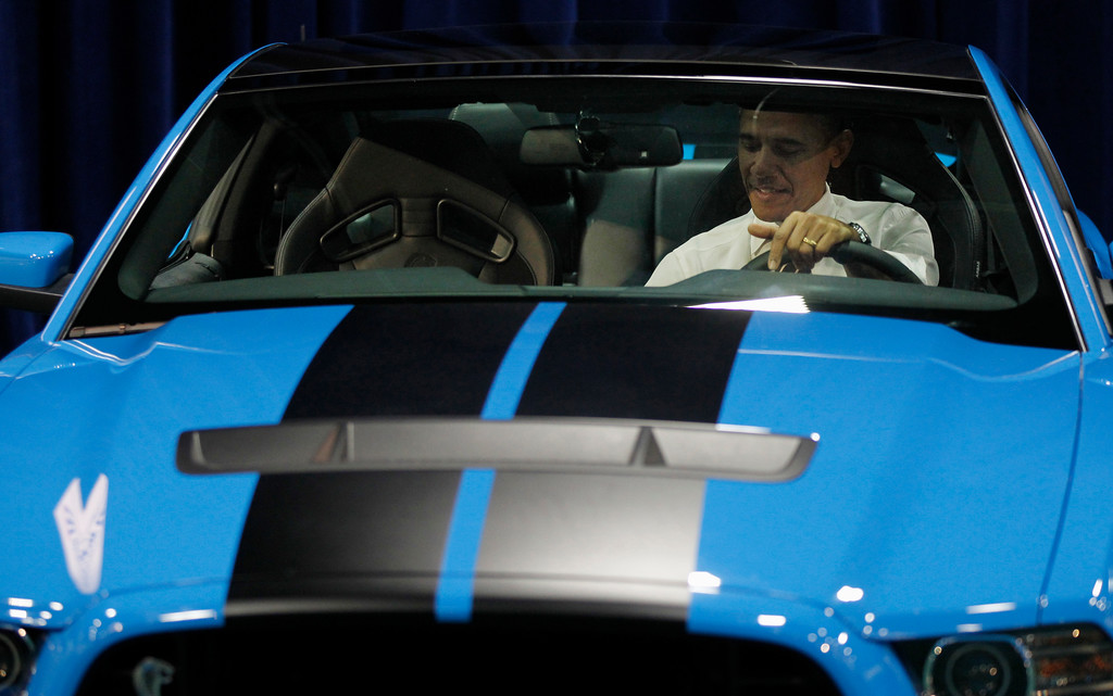 . President Barack Obama sits inside a Ford Mustang Shelby GT500 during his visit to the Washington Auto Show at the Washington Convention Center in Washington, Tuesday, Jan., 31, 2012. (AP Photo/Pablo Martinez Monsivais)