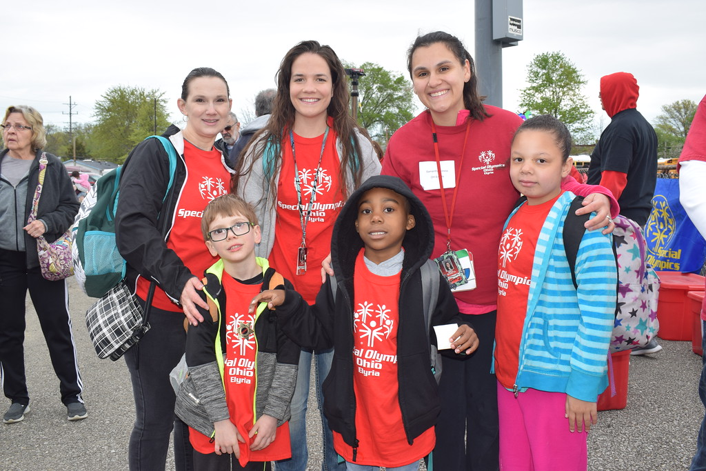 . Briana Contreras � The Morning Journal <br> Top left, Paraprofessional Tammy Adams, Special Education teacher Courtney Clark and Intervention Specialist Samantha Boneta of Franklin Elementary School in Elyria are volunteer coaches to their students from left, Aiden Harrison, 6, Terrell Jackson, 5, and Darielle Robinson, 6. The three athletes are the only from Franklin who participated in the 38th Annual Lorain County Special Olympics May 11.