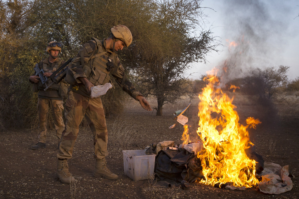 ". French soldiers from the 92nd Regiment Infantery burn items allegedly belonging to Mujao forces on April 8, 2013 during a military operation some 105 kilometers North of Gao. A French force of 1,000 soldiers in a major offensive has swept a valley thought to be a logistics base for Al-Qaeda-linked Islamists near the Malian city of Gao. Operation Gustav, one of France\'s largest actions since its intervention against insurgents in January, will involve dozens of tanks, helicopters, drones and airplanes, said General Bernard Barrera, commander of the French land forces in Mali.  France is to start withdrawing its 4,000 troops from Mali at the end of April, and plans to leave a ""support force\"" of 1,000 soldiers after elections promised for July. JOEL SAGET/AFP/Getty Images"