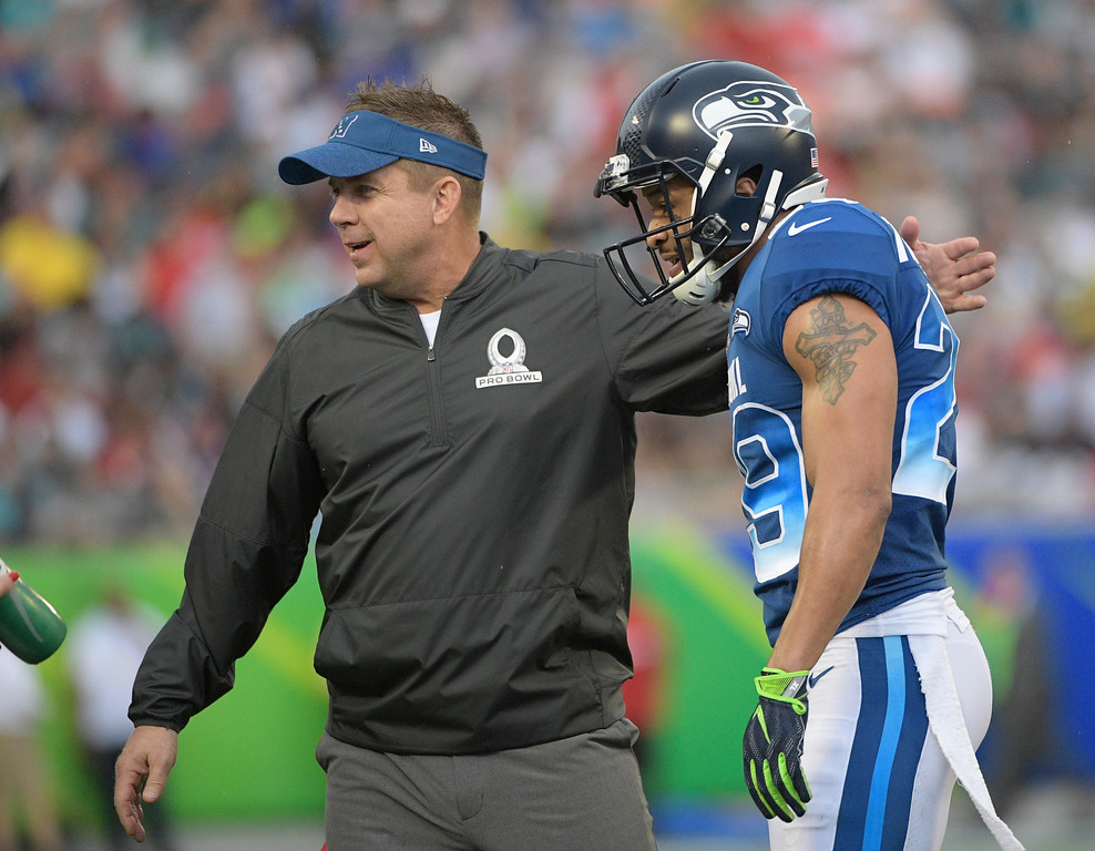 . Sean Payton greets NFL free safety Earl Thomas (29), the Seattle Seahawks, during the first half of the NFL Pro Bowl football game against the AFC, Sunday, Jan. 28, 2018, in Orlando, Fla. (AP Photo/Phelan M Ebenhack)