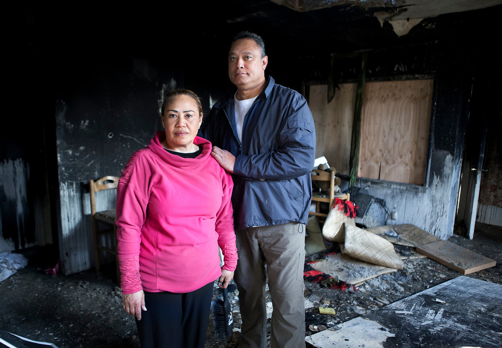 . From right, Uatesoni Paasi and Anna Paasi at their house that was destroyed by a fire in December, in San Mateo, Calif. on Thursday, Jan. 2, 2014.  (LiPo Ching/Bay Area News Group)