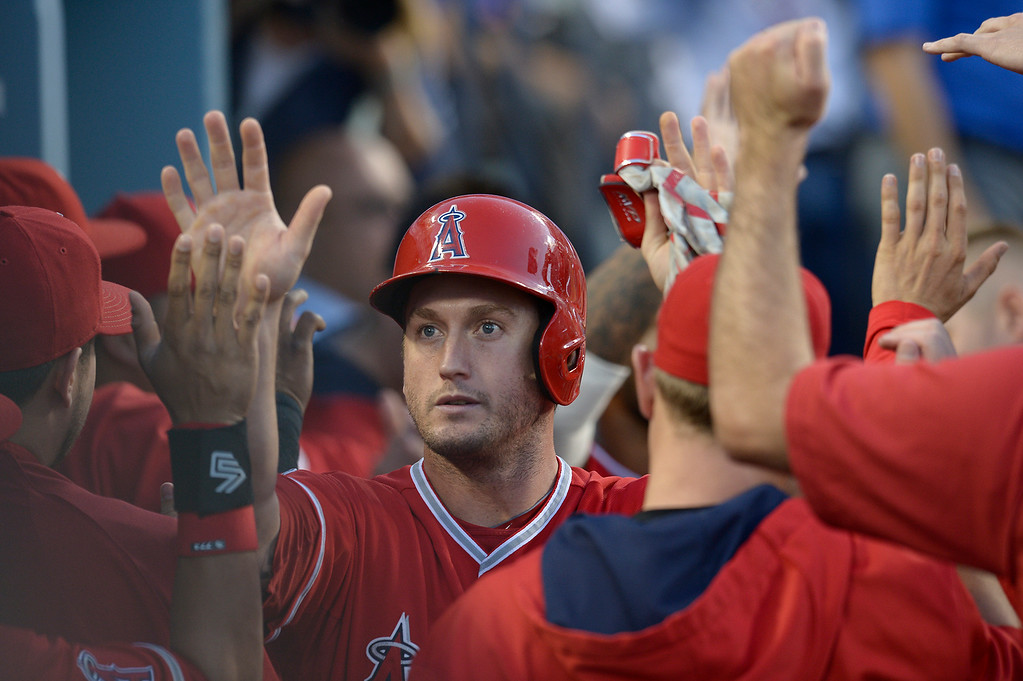 . David Freese gets high fives in the dugout after he was driven in by Chris Iannetta in the 2nd inning. The Dodgers played the Angels at Dodger Stadium in Los Angeles CA. 8/5/2014(Photo by John McCoy Daily News)