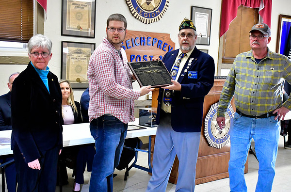 12/7/2018 Mike Orazzi | Staff Post 2 Commander Rick Schreiner presents Thomas LeBeau with a plaque of the USS Kidd during a Pearl Harbor ceremony in Bristol Friday morning.