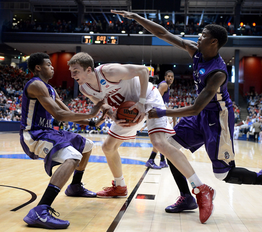 . DAYTON, OH - MARCH 22:  Cody Zeller #40 of the Indiana Hoosiers handles the ball against Charles Cooke #4 and Andre Nation #15 of the James Madison Dukes of the James Madison Dukes in the first half during the second round of the 2013 NCAA Men\'s Basketball Tournament at UD Arena on March 22, 2013 in Dayton, Ohio.  (Photo by Jason Miller/Getty Images)
