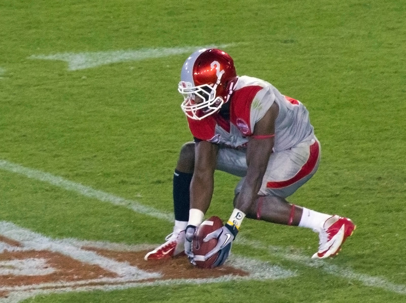 UH kickoff returner picks the ball off the turf